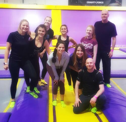 Aventri employees having some fun at a trampoline park