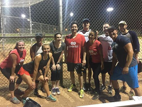Aventri employees participating in a friendly game of softball