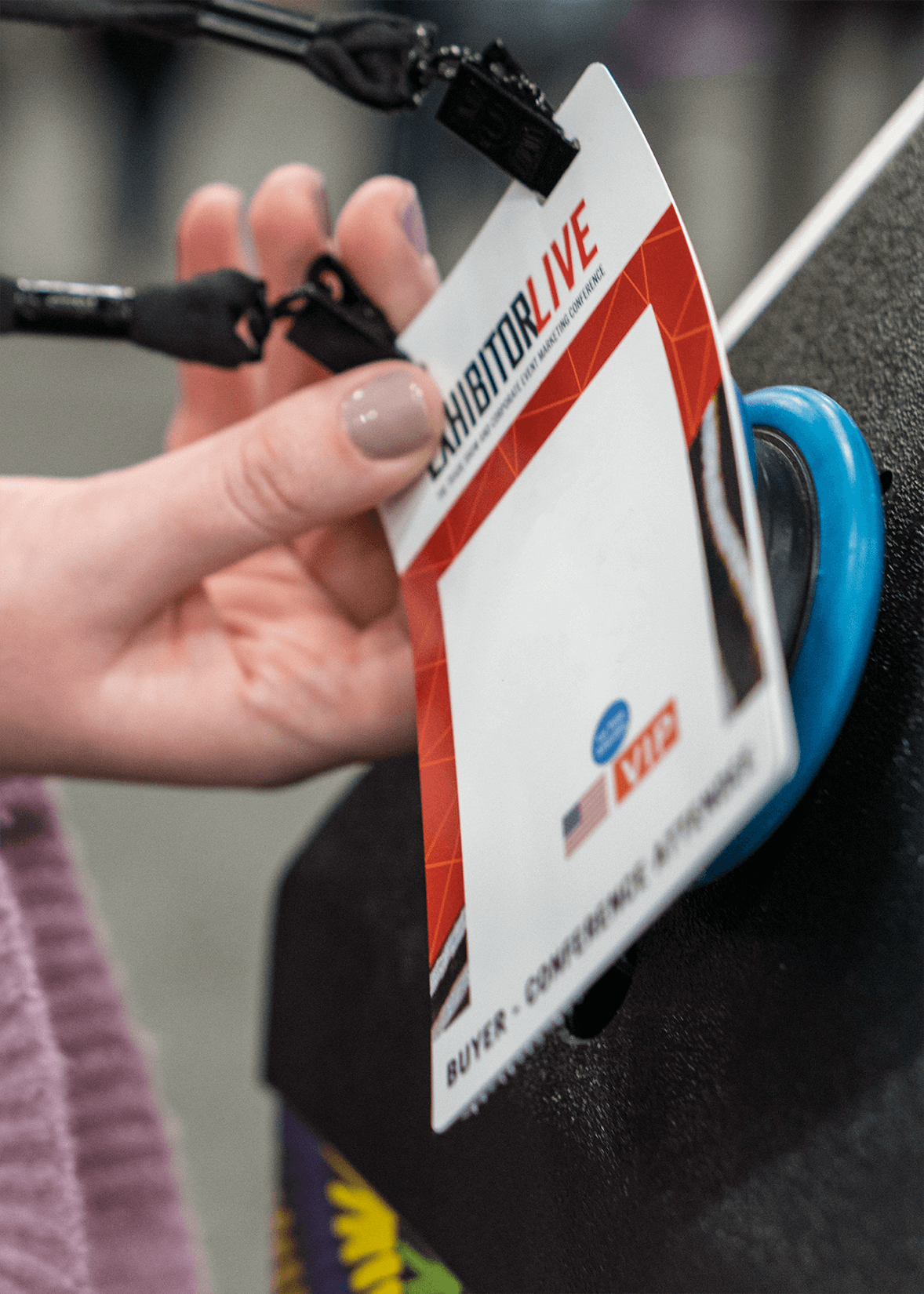 Attendee Badge being scanned at tap n' go pod at an event