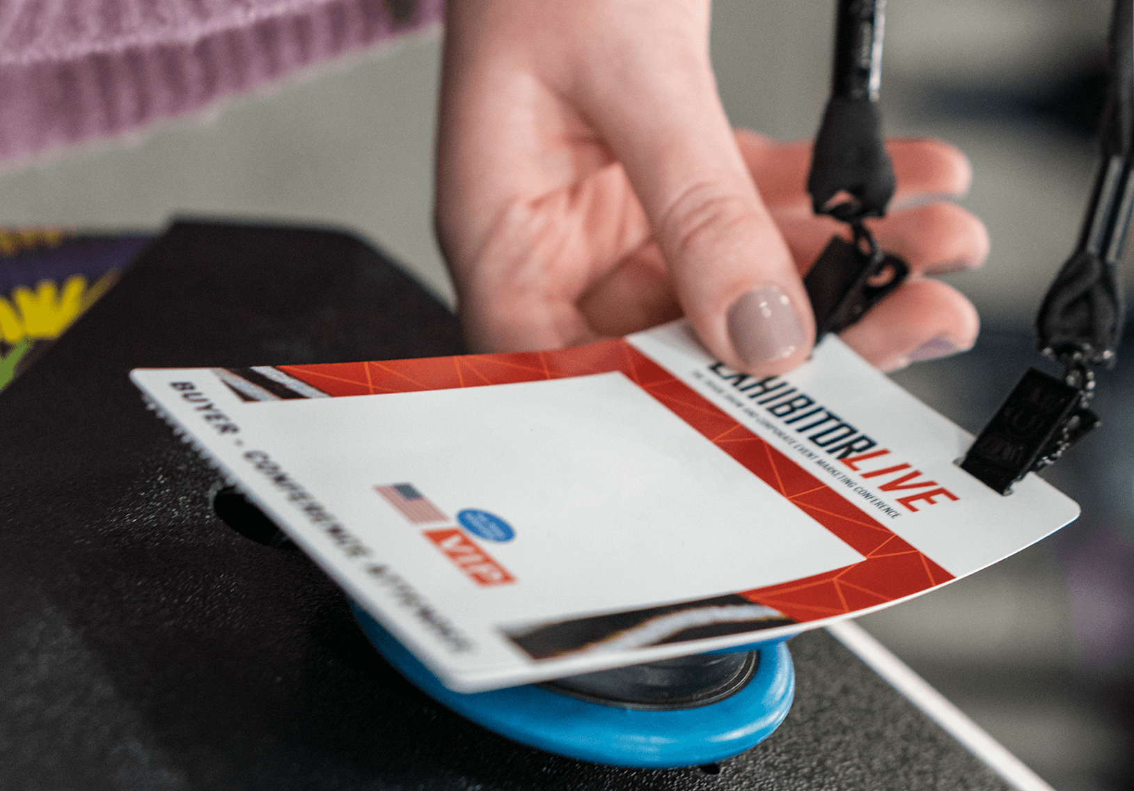 attendee using their event badge to access a session during a trade show