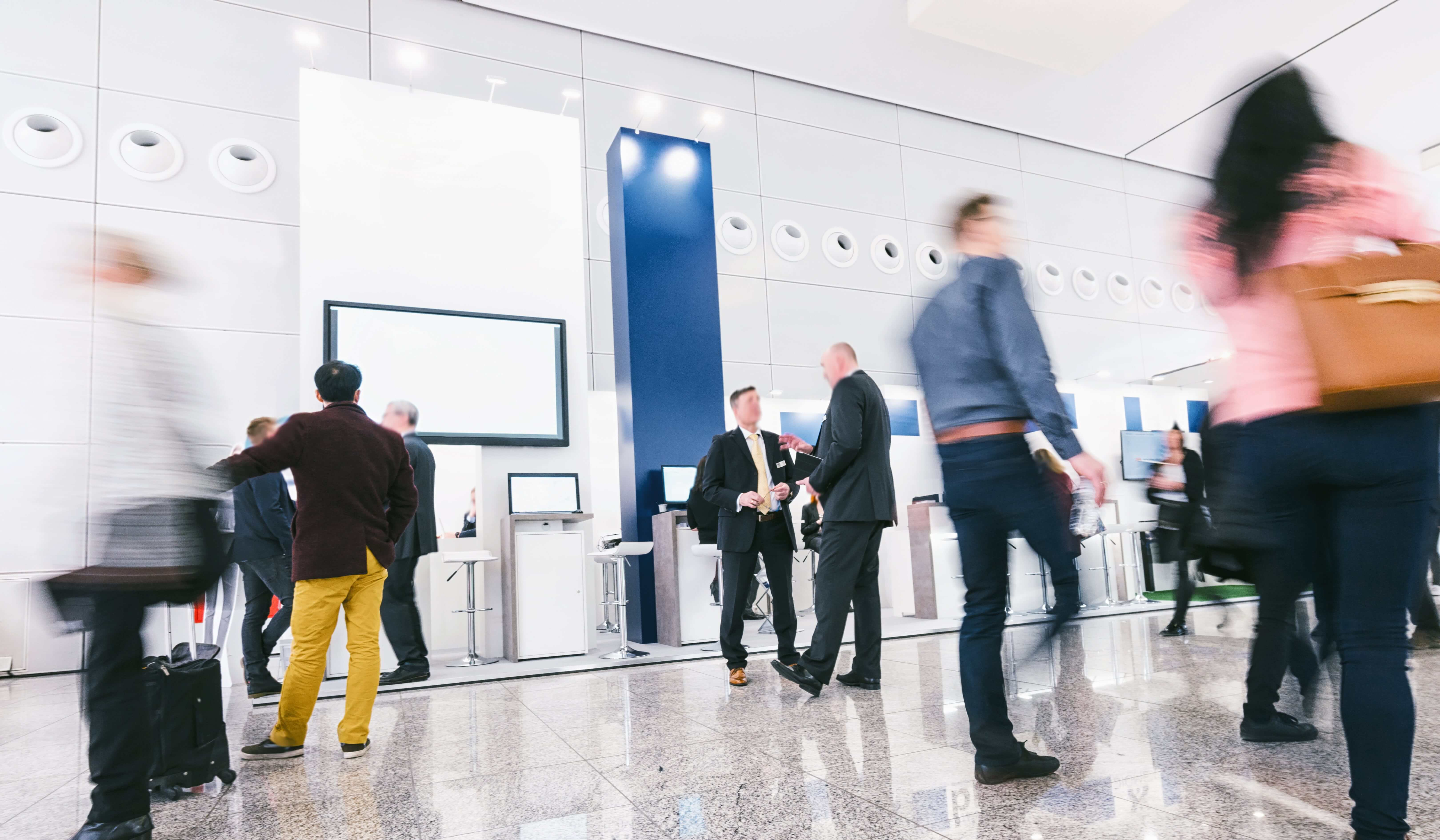 Event attendees walking through exhibit hall using event technology