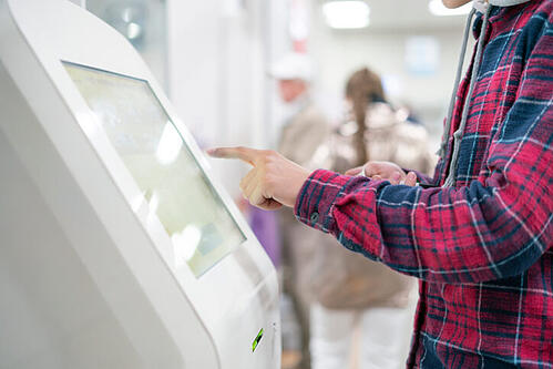 Attendee using a self-service kiosks to check-in at an event