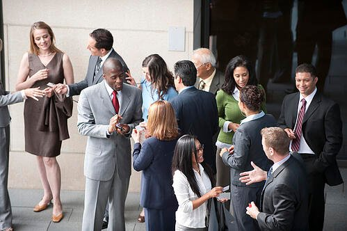 Attendees networking at a corporate event