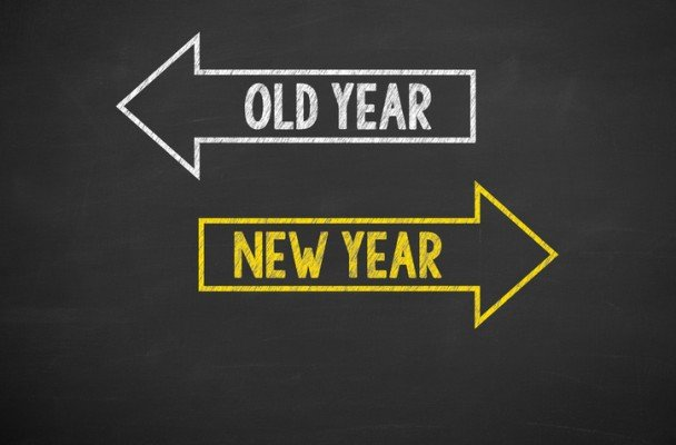 """A white arrow pointing to the left with the words"""" Old Year"""" and a yellow arrow pointing to the right with the words """"New Year"""""""