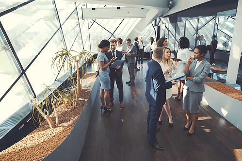 A group of business people engaging with each other at a corporate event