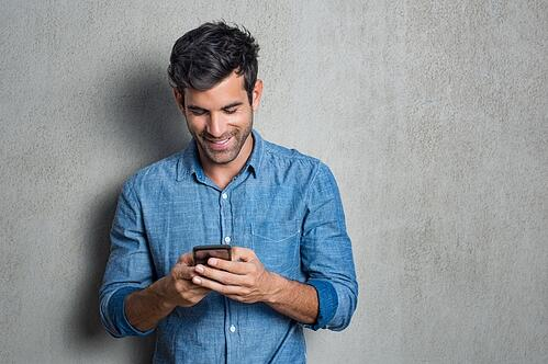 Male event attendee using his mobile phone