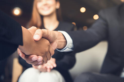 Event planners engaging and shaking hands
