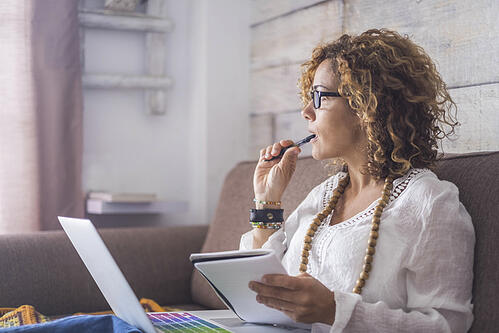 female event planner working at her home office