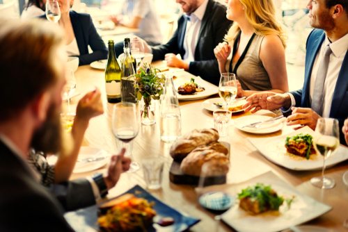 Group of diverse business professionals having a networking dinner