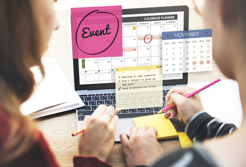 event professionals sitting at their desk pre-event planning for success
