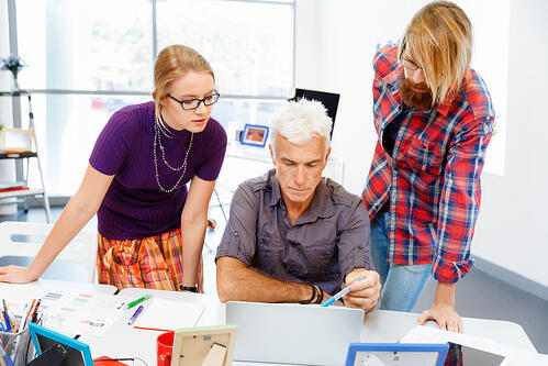Event team members working together in an office