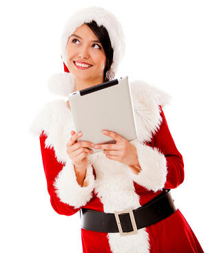Thoughtful Mrs Claus with a tablet computer - isolated over a white background