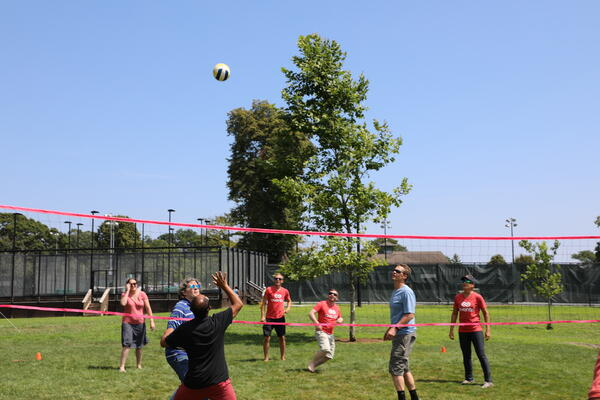 Aventri employees playing volleyball