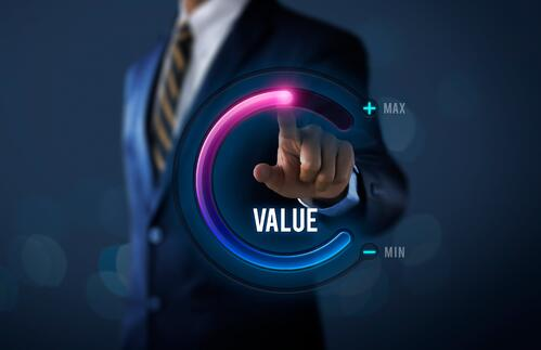 Businessman is pulling up circle progress bar with the word VALUE on dark tone background