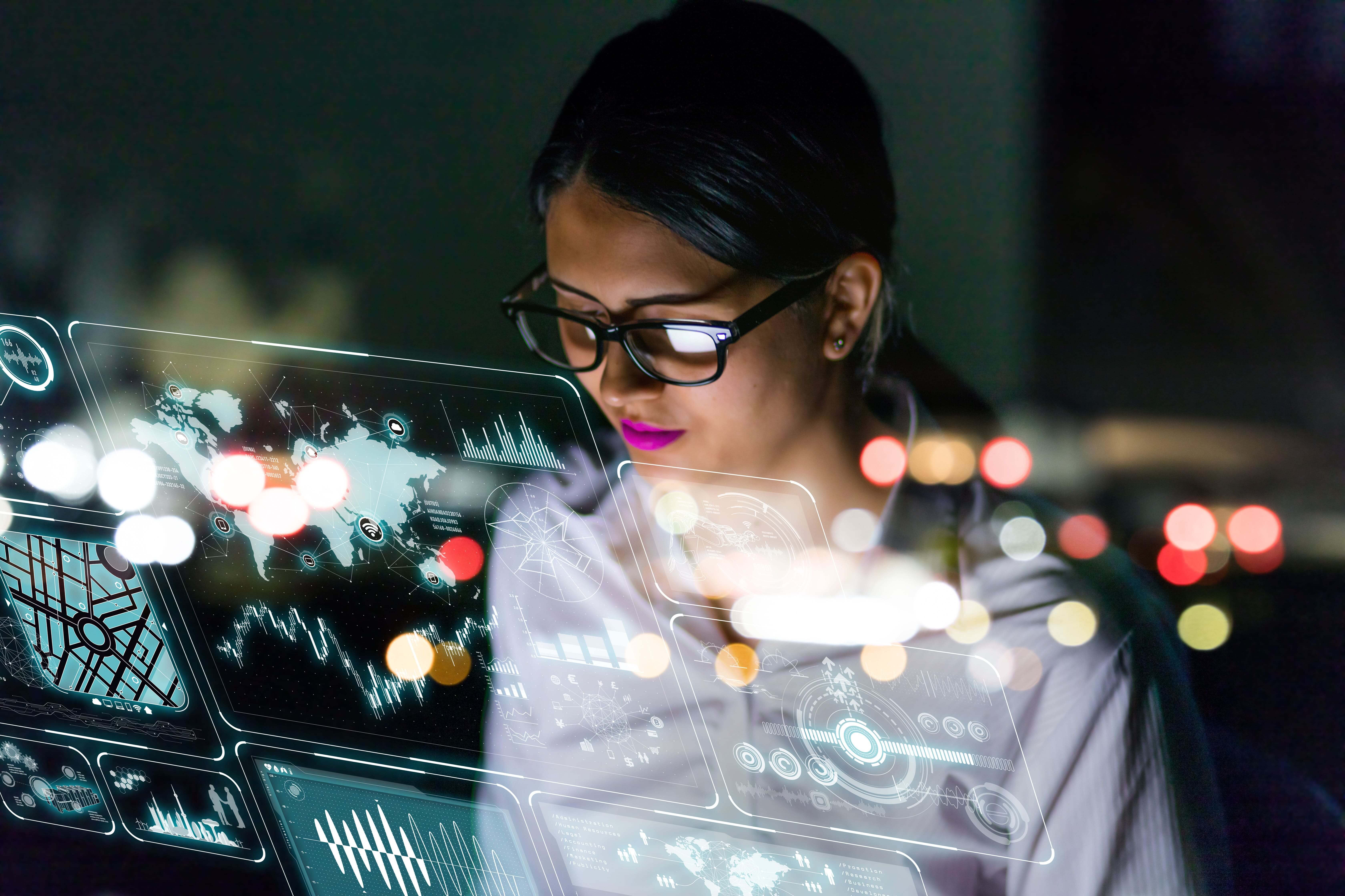 businesswoman looking at higher education event data