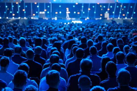 Audience listening to a speaker at a conference