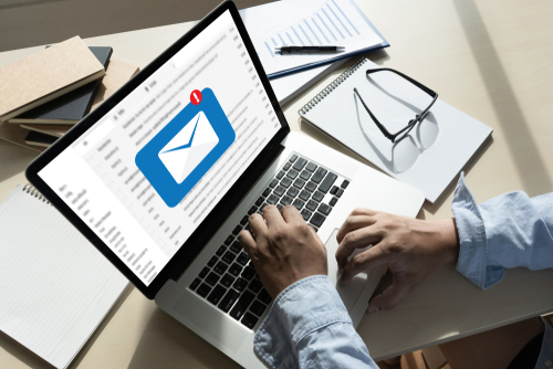 event professional working on email marketing campaign to reach event attendees