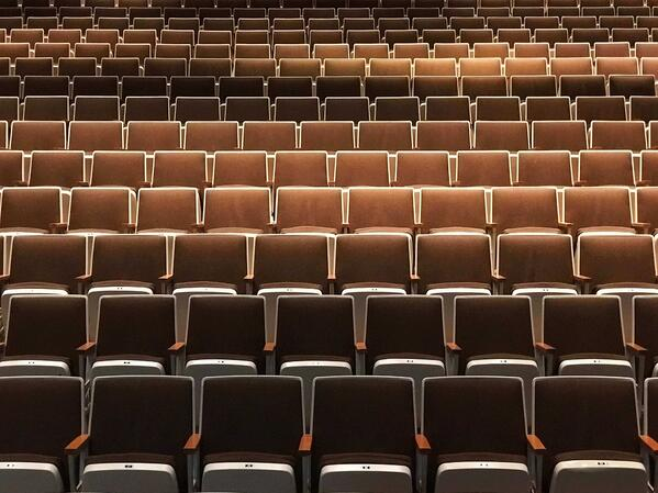 empty brown conference chairs
