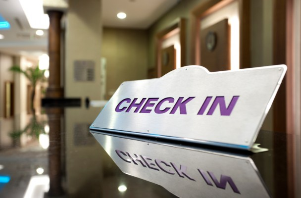 Check In sign on a table