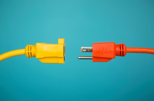 Yellow and orange extension cords being connected