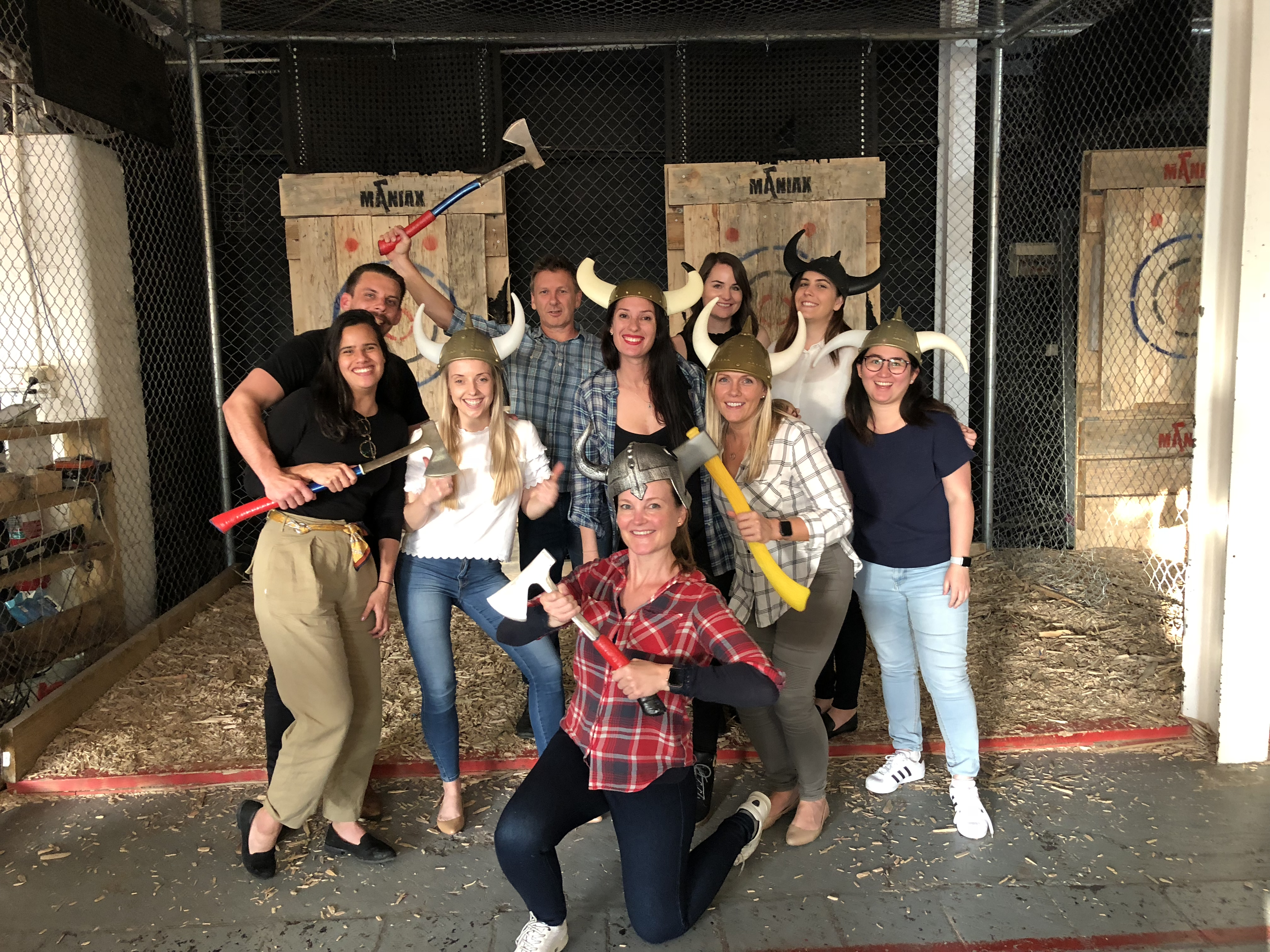 Aventri employees de-stressing with hatchet throwing