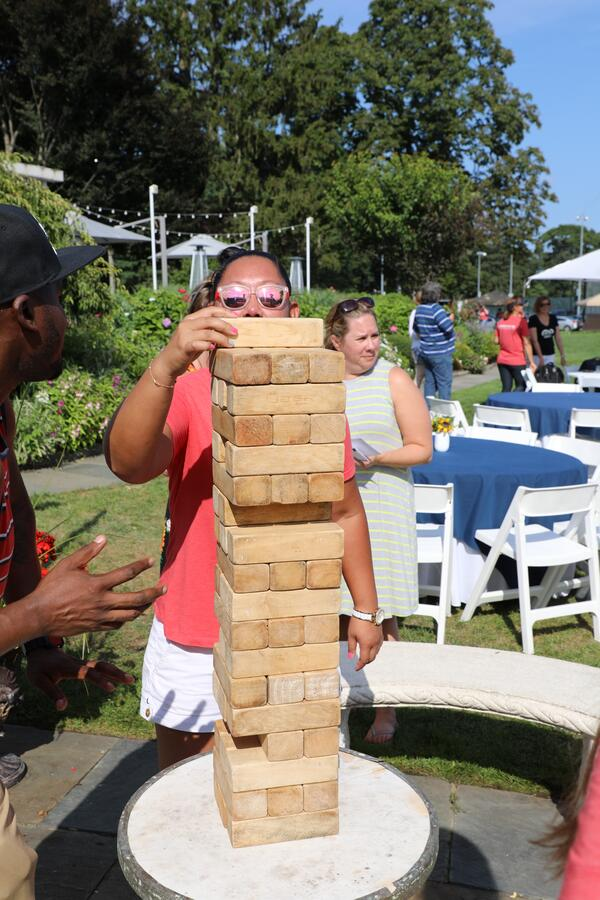 Aventri employees playing giant Jenga