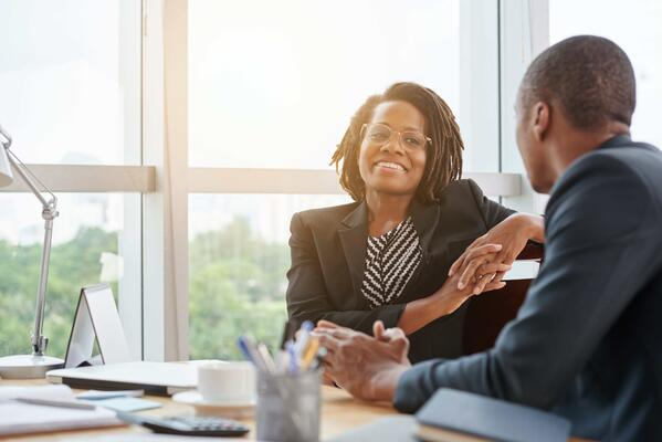 female event professional having an engaging conversation with an event sponsor