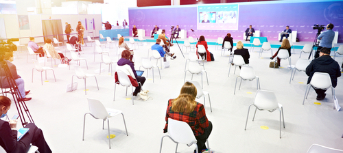 attendees spaced out for social distancing during a hybrid event