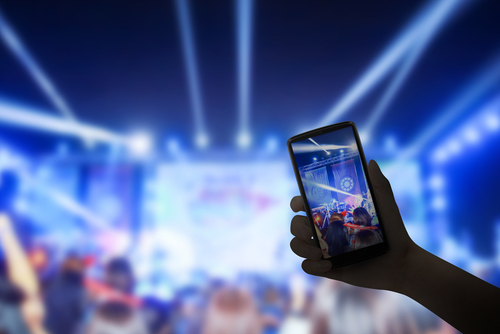 attendee streaming a an event live on social media
