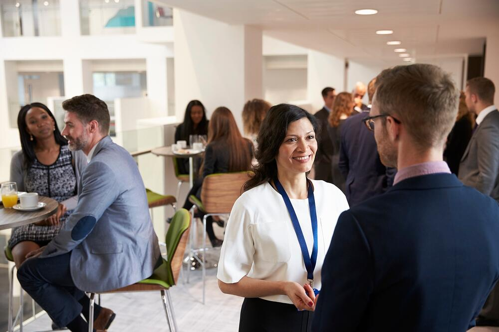 Business professionals networking while at an event