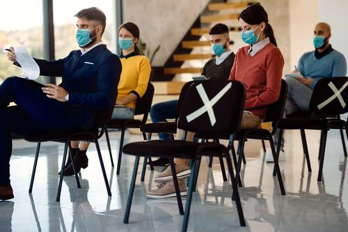 event attendees wearing face mask at a socially distanced business event