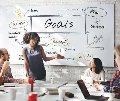 event professionals gathered around a conference table brainstorming sponsorship goals