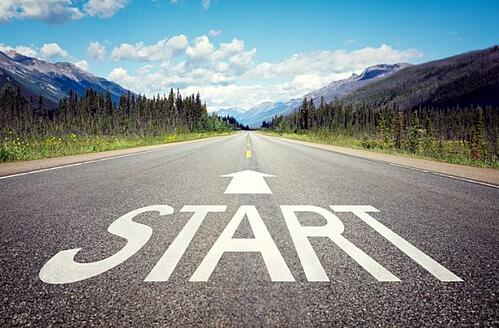 start sign placed in the middle of a road to symbolize the start of an event management software migration