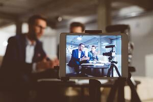 business professionals recording a video