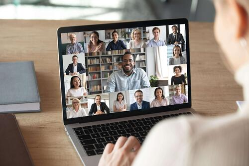 Attendee sitting in their home office attending a virtual conference