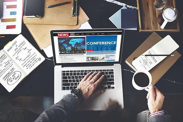 business professional attendee a  virtual conferences from his home